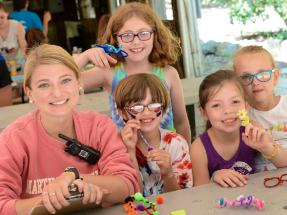 arts and crafts with kids and counselor
