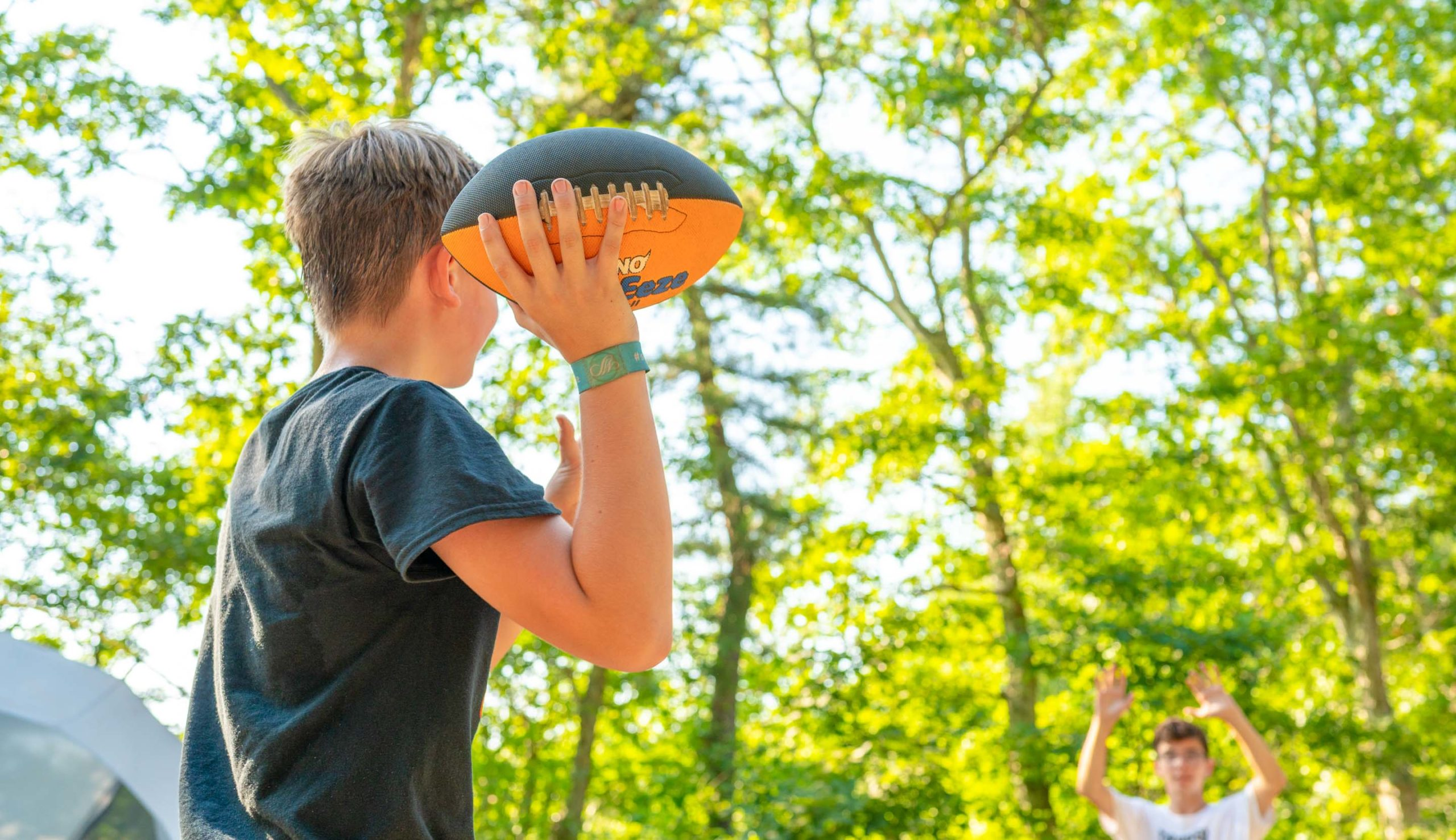 Camper throwing a football