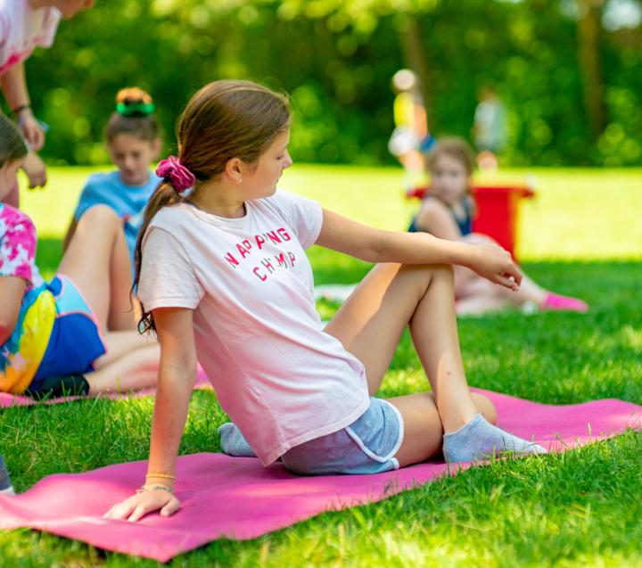 Camper doing yoga