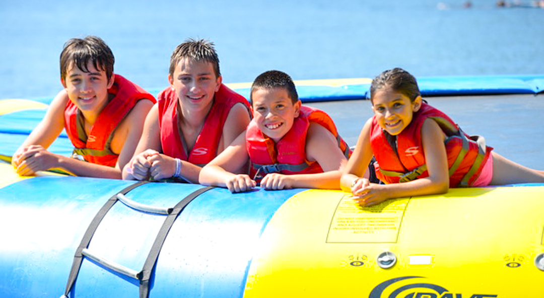 Four kids on water trampoline