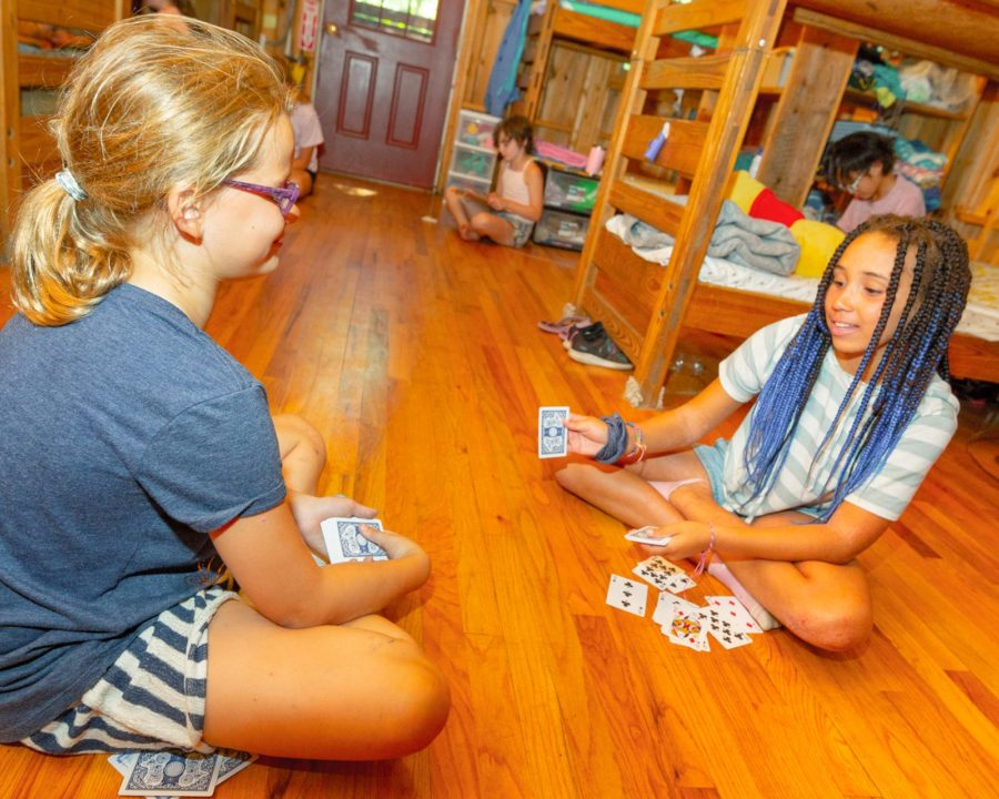Campers playing cards in their bunks
