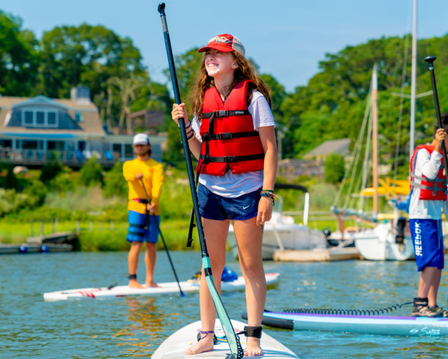 Camper stand up paddle boarding