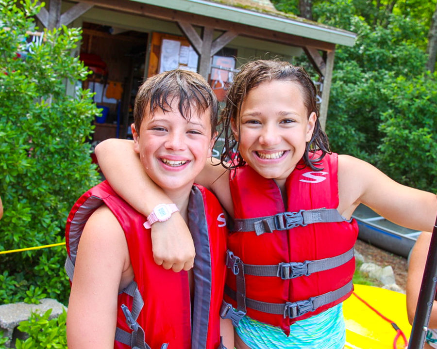 Two campers in life vests